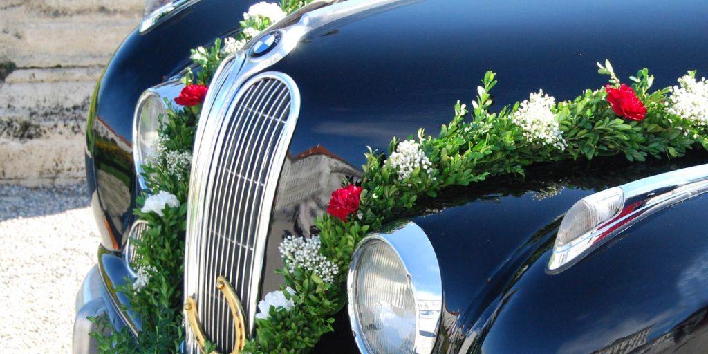 BMW with wedding decoration