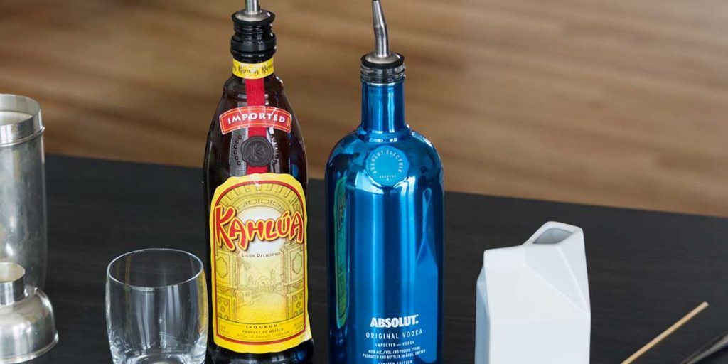 Kahlua and Absolut Vodka bottles, and the ingredients for White Russian