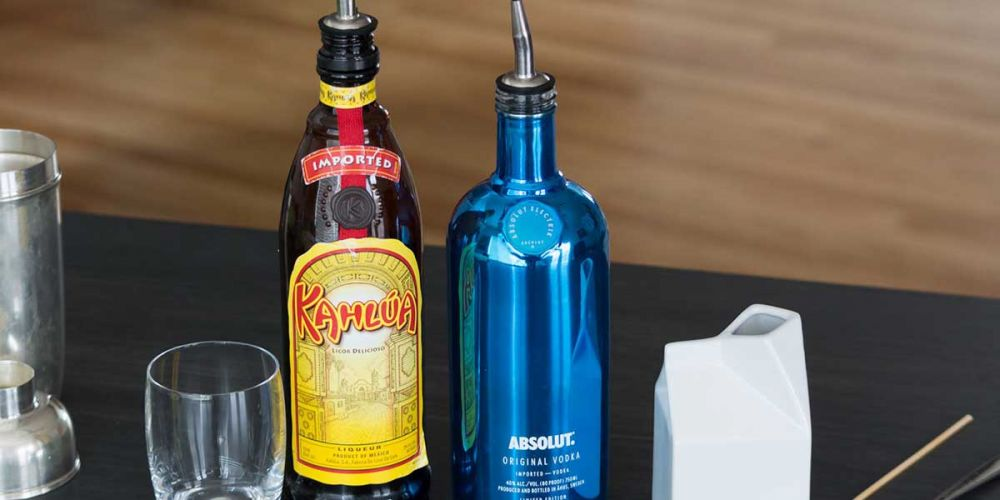Kalhua and Absolut Vodka bottles, and the ingredients for White Russian