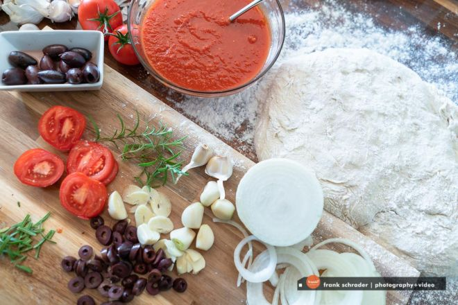 Pizza making ingredients, vertical from above